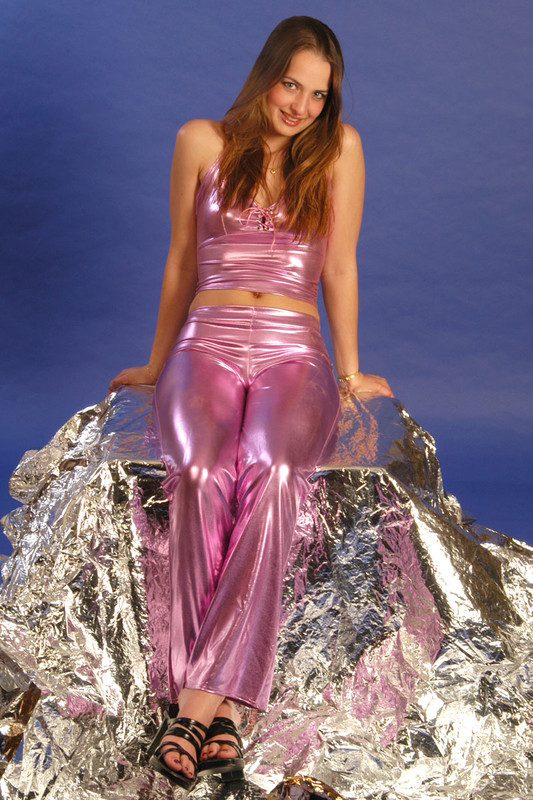 sweet coed teen in shiny purple clothes